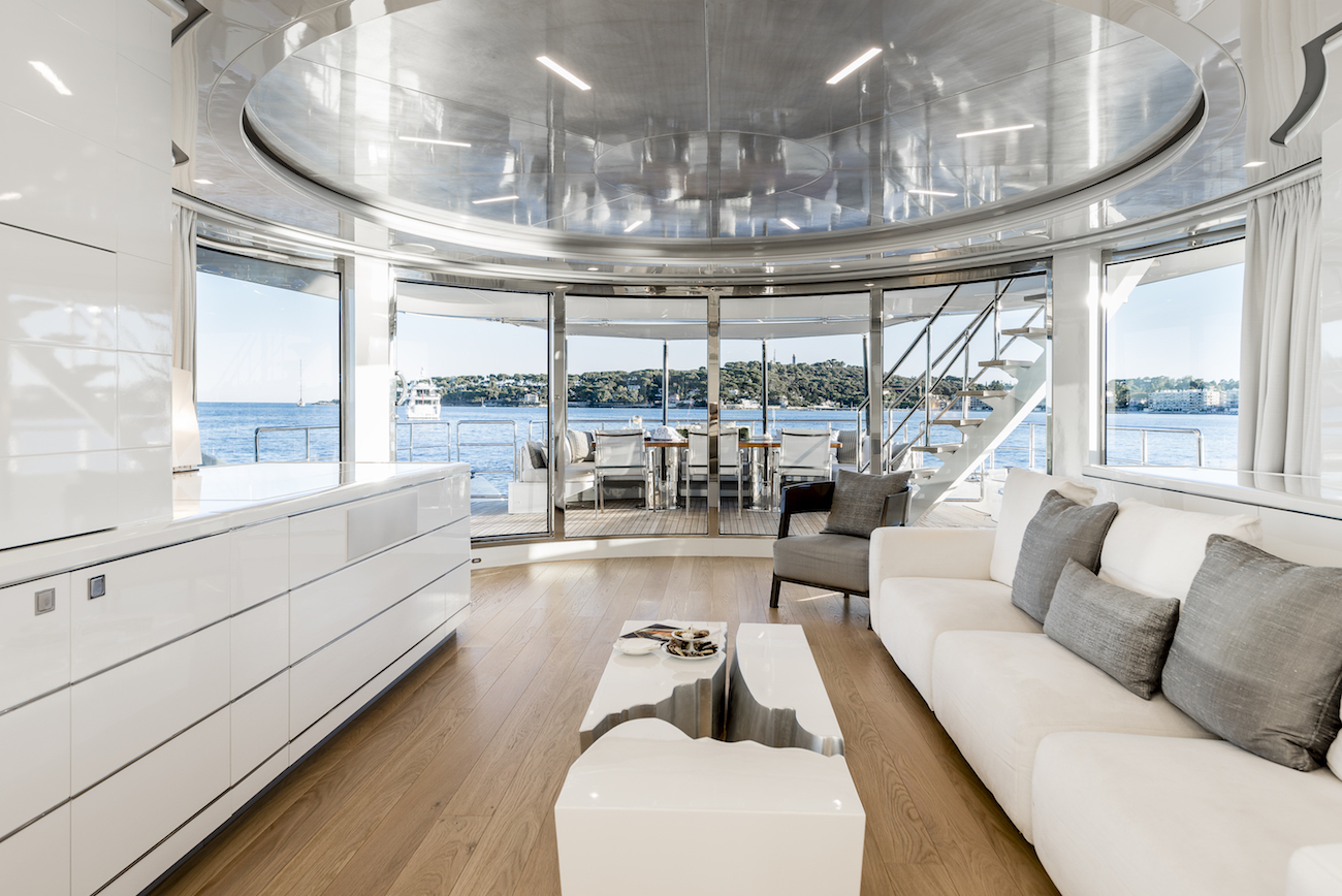 Main Saloon With The View Aft Onto The Exterior Deck Area