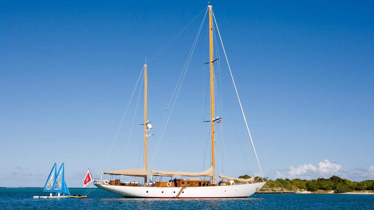 Yacht TIZIANA By Abeking & Rasmussen - Anchored In The Caribbean With Sailing Dingeys