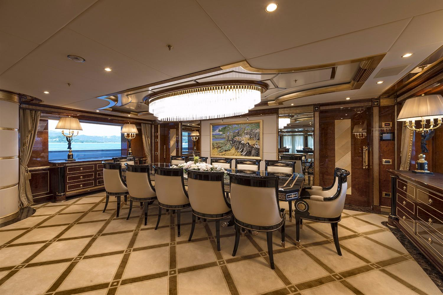 Formal Dining Area With A Beautiful Large Table And Plush Seating