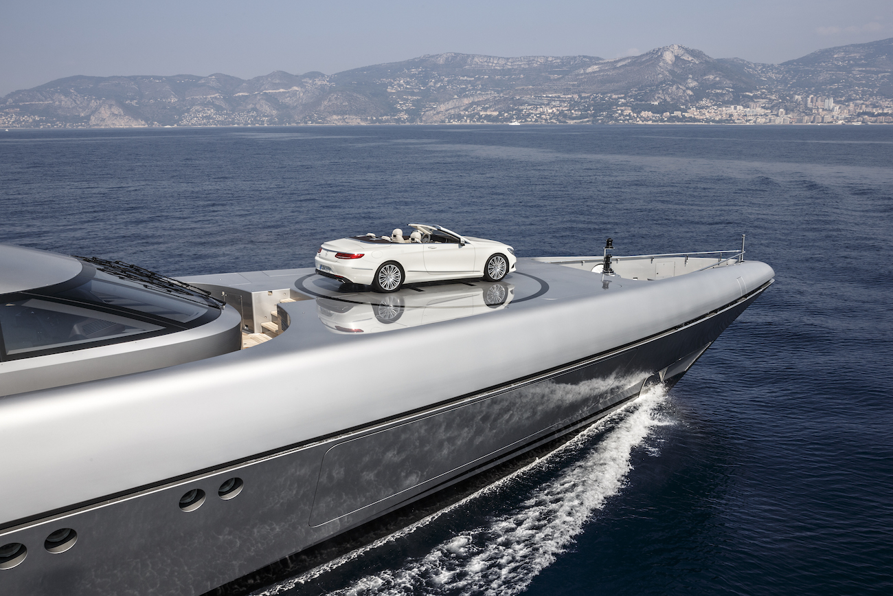 Luxury Yacht With Mercedes S-Class Convertible On Helipad