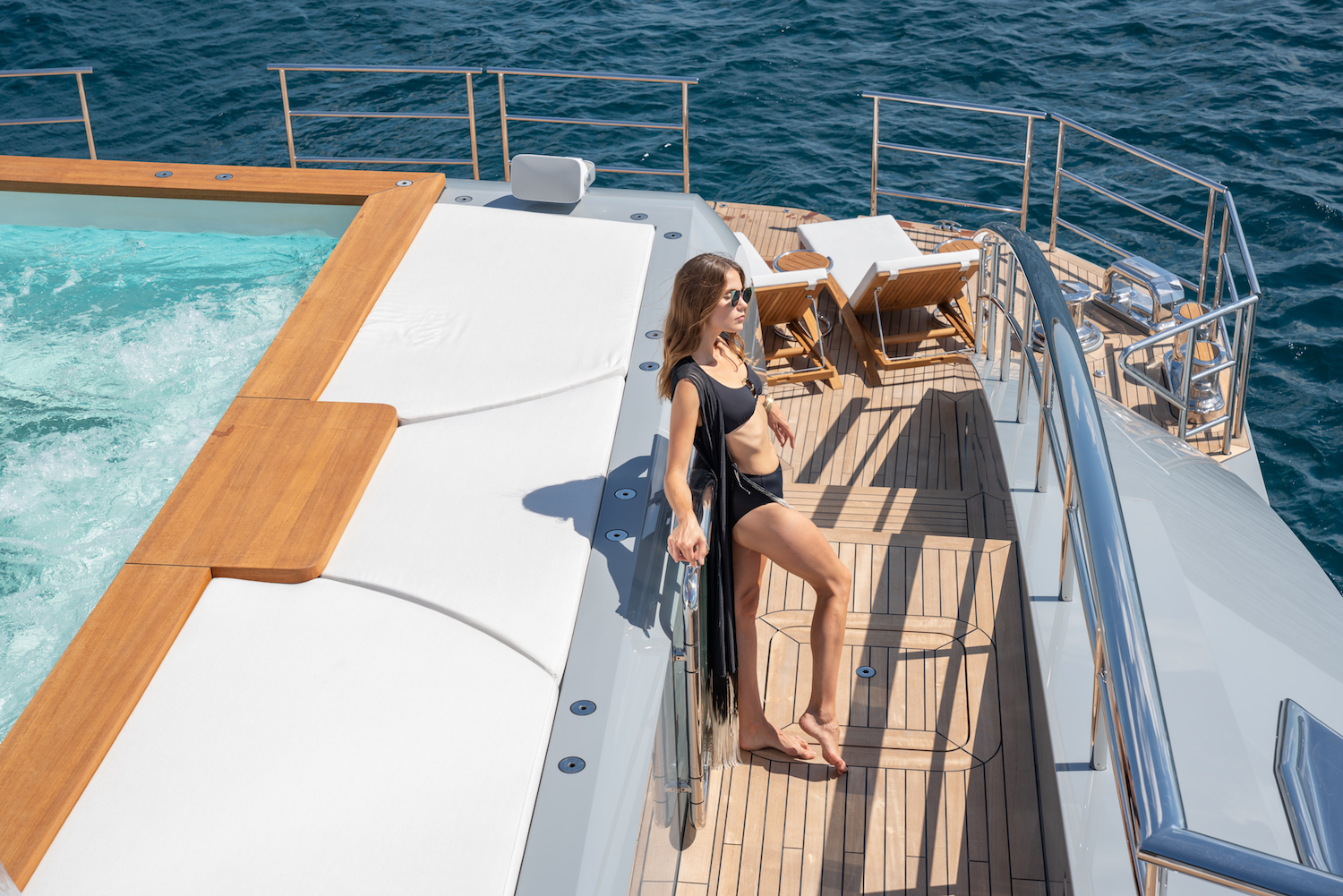 Model Next To The Pool On A Superyacht