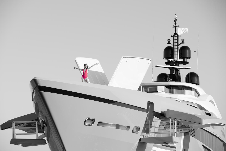 Model On A Bow Of A Mega Yacht