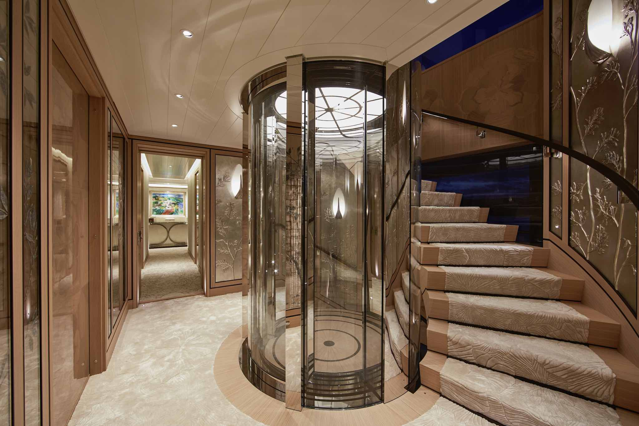 Stairwell With The Glass Elevator