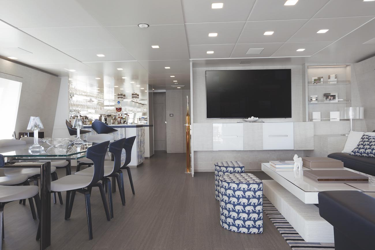 Upper Deck Lounge With TV And Dining Table On The Left