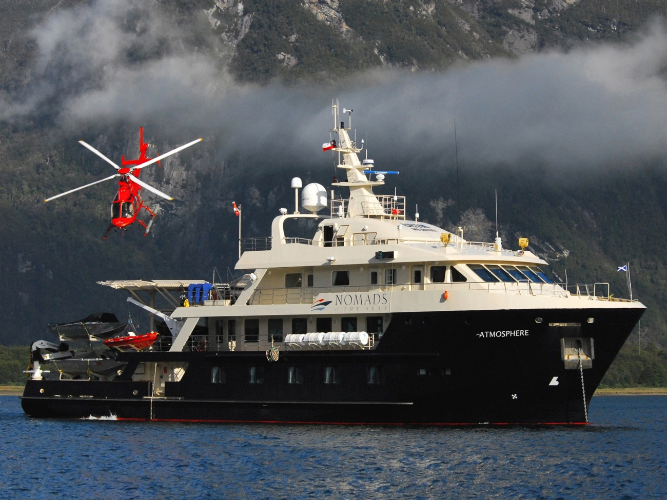 Overview Including Chopper Aboard Yacht ATMOSPHERE