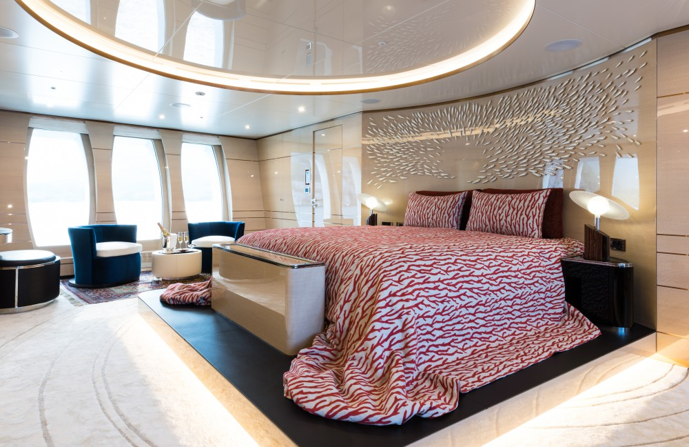 Master Suite With Beautiful Bedding And Seating Area