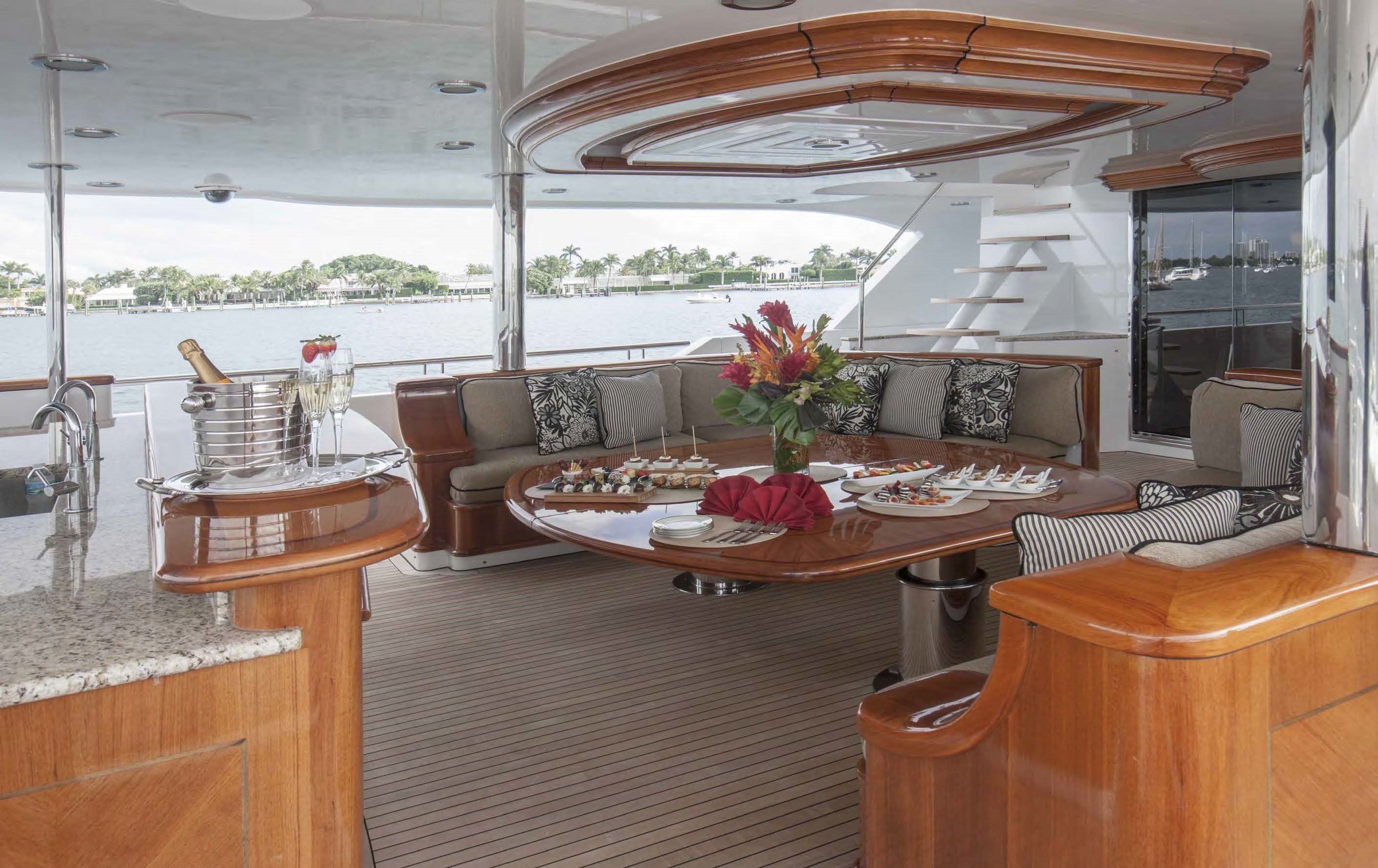 Aft Deck Adjustable Table For Dining And Full Bar With TV