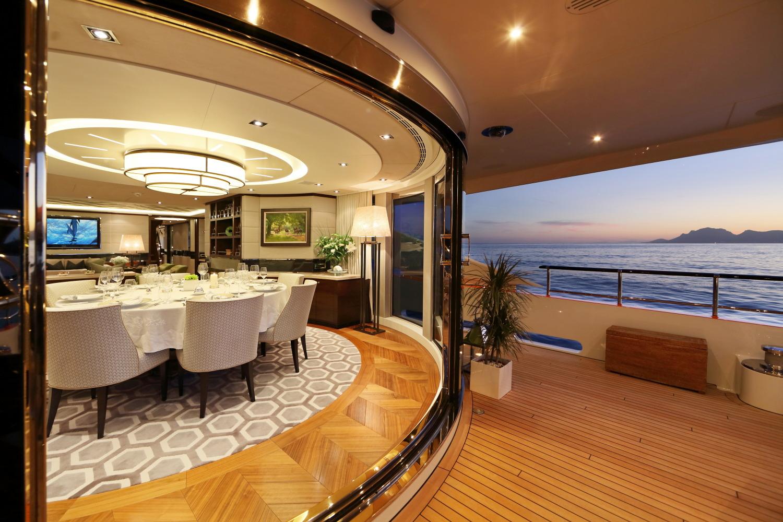Heesen yacht AURELIA - Formal dining from aft deck