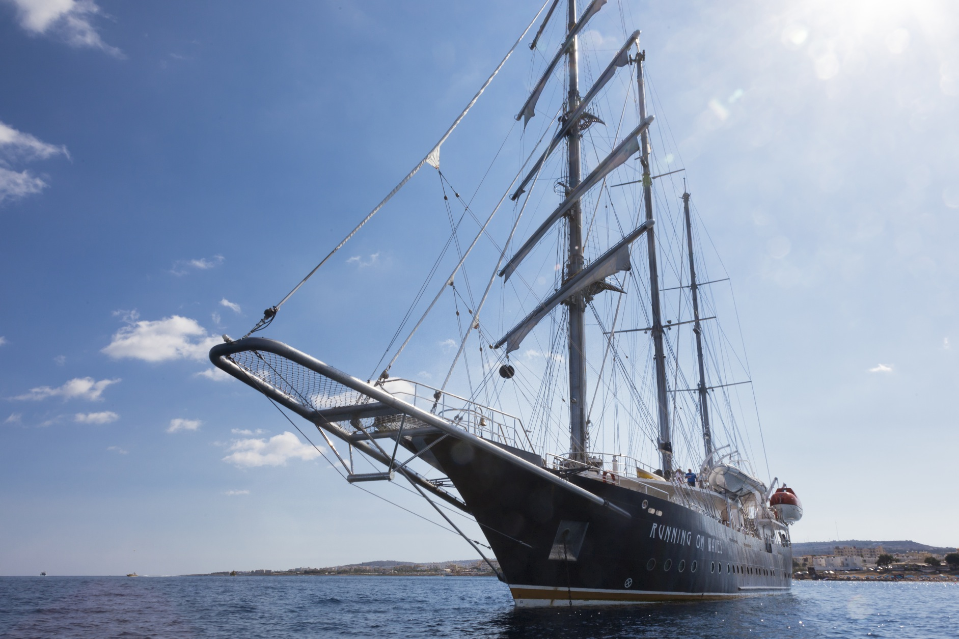 Sailing yacht RUNNING ON WAVES -  Bow