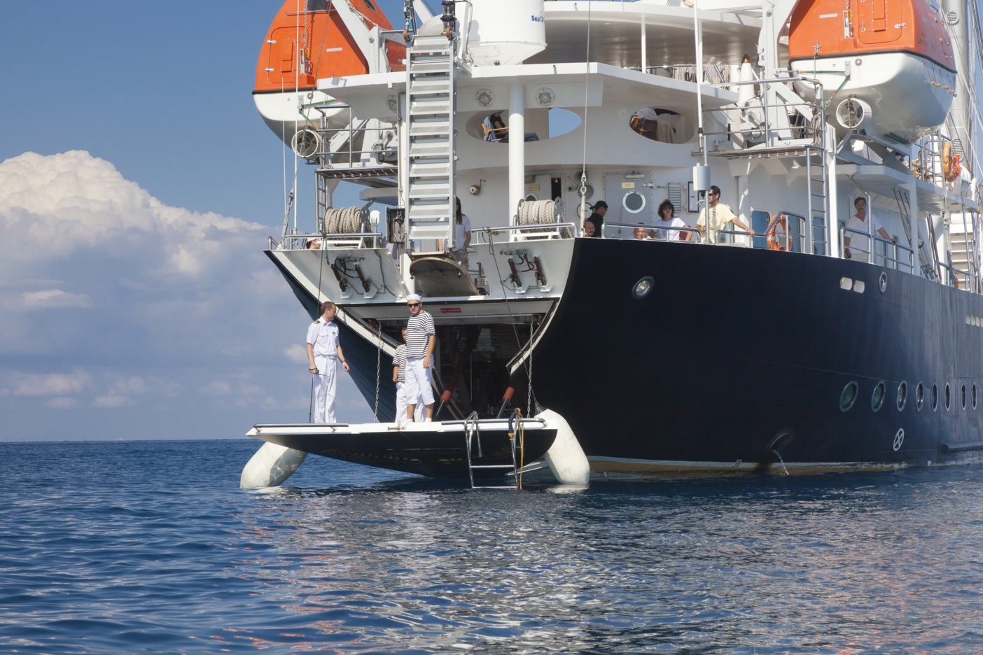 Sailing yacht RUNNING ON WAVES -  Stern
