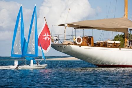 Tiziana at anchor and sailing dinghies