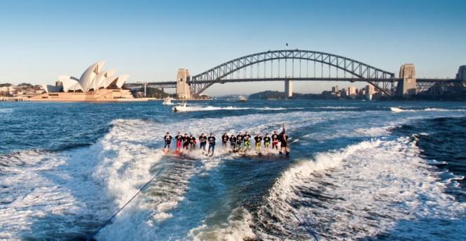 Riviera 61 series II Enclosed Flybridge luxury motor yacht and elite water skiers in Sydney Harbour