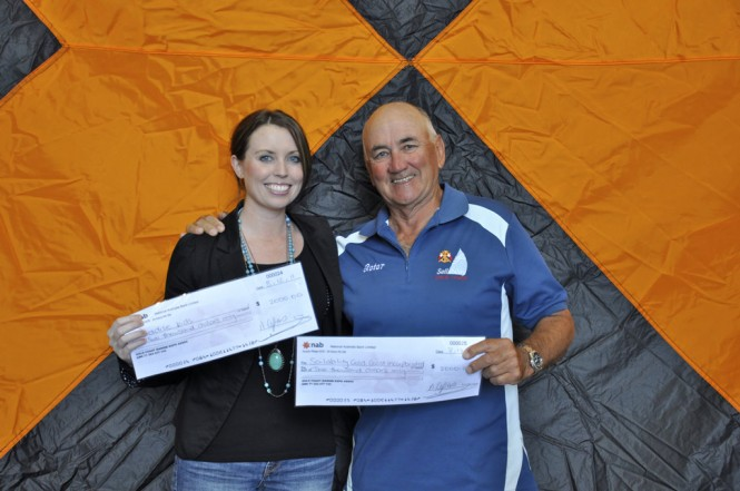 Brodie Sheiles from Paradise Kids and Peter Board from Sailability with their cheques from GCME (2)