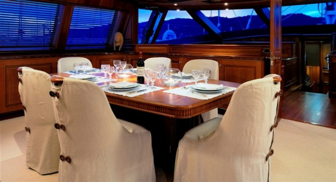 Dining on board of charter yacht Drumbeat