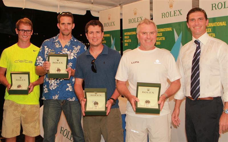 ALEXANDRE TABARY-DEVISME (FAR RIGHT), ROLEX CARIBBEAN, HANDS ROLEX TIMEPIECES TO THE WINNERS OF THE WEEK: (FROM RIGHT) JEREMY PILKINGTON, RICHARD WESSLUND, ROBBIE RAMOS AND DALTON DEVOS