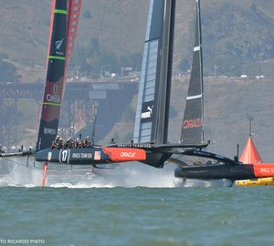 34th America's Cup: ORACLE TEAM USA captures Race 12 to stay alive