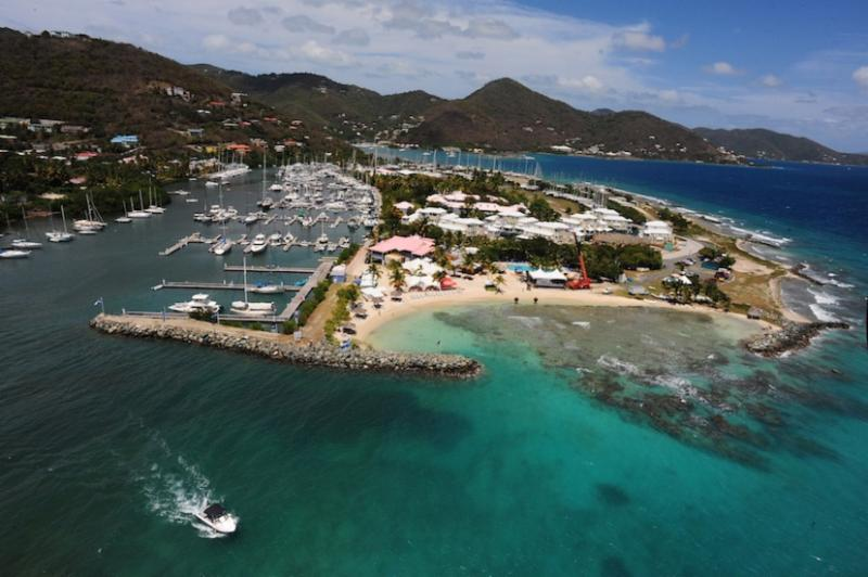 The boats are all out racing but Todd vanSickle manages to swing by Nanny Cay in the helicopter to capture this great aerial view of the Race Village and whole Nanny Cay site