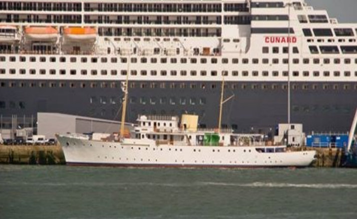 Classic yacht Shemara berthed in Southampton with one of the Cunard's fleet of cruise liners in the background