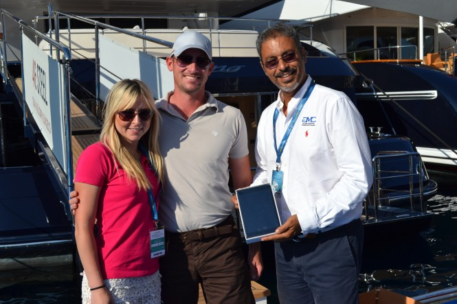GMC and Yachting Pages awarding an iPad mini to Daniel from superyacht Starling
