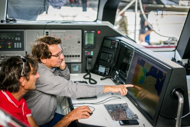 Jean-Paul Riviere and Jacques Delorme on board Finot-Conq 100, Nomad IV, study the weather before the start of the RORC Transatlantic Race - Image by RORC James Mitchell