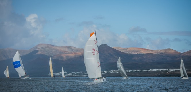 Next stop Grenada - RORC Transatlantic Race fleet with the dramatic Lanzarote landscape in the background - Image by RORC James Mitchell