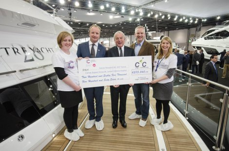 Cogs4Cancer present a cheque for €285,560.06 to Cancer Research UK at the London Boat Show. L to R – Chloe William (CRUK), Ben Young (President of C4C and MD of Sunseeker SYM), Robert Braithwaite CBE (Autumn Trust), Steve Crowe (C4C Rider and MD of Yachting Pages) & Felicity Louden (CRUK)
