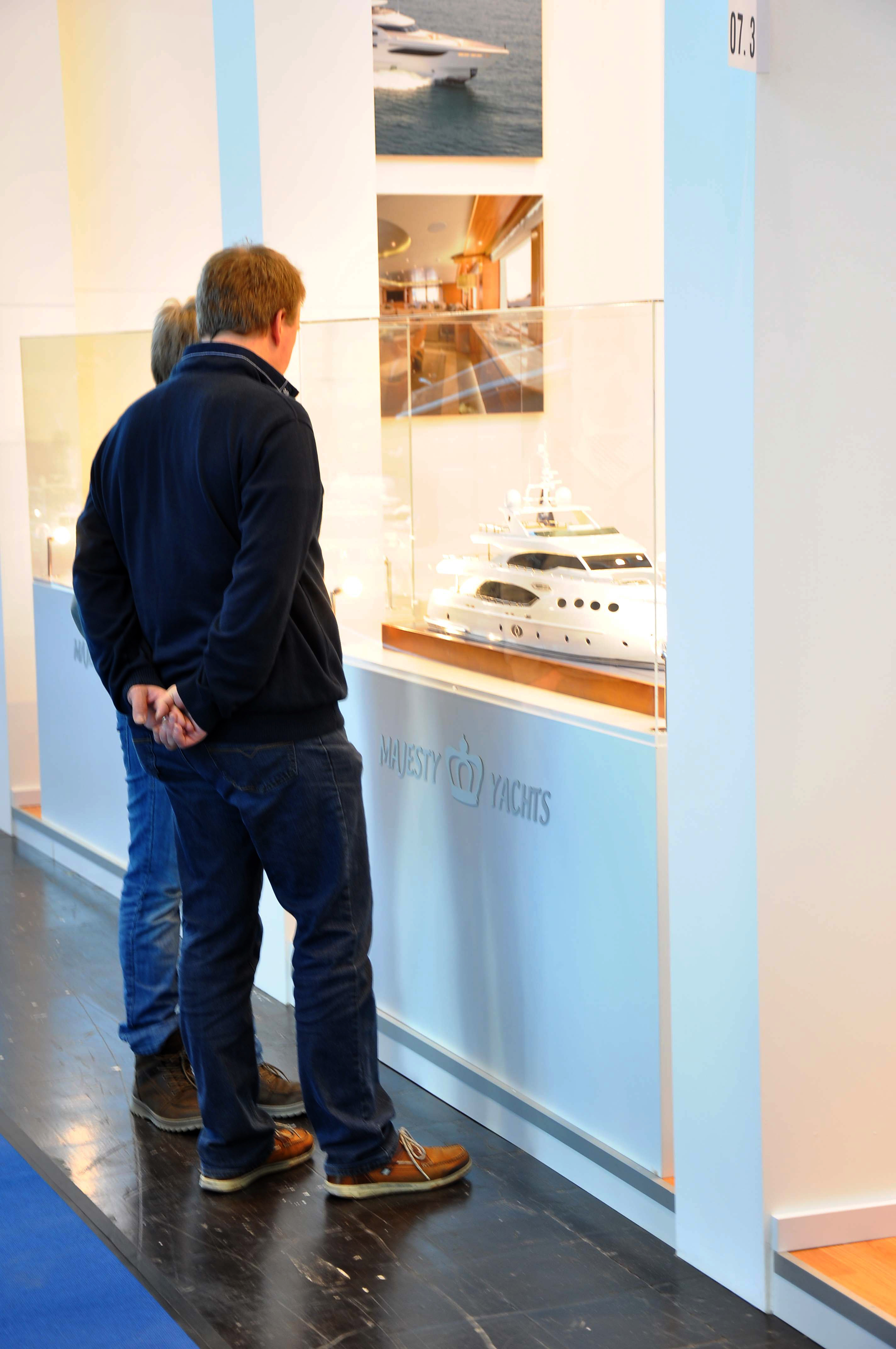 Guests checking out the Majesty 135 scale model at the Dusseldorf Boat Show 2014