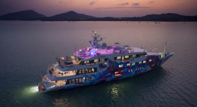 Luxury motor yacht Saluzi by night
