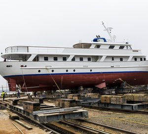 Re-launch of classic superyacht Moon Maiden II during a solar eclipse at Solent Refit
