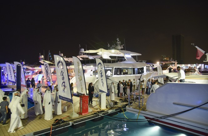 Visitors at the Qatar International Boat Show 2015 cue to view the Gulf Craft fleet