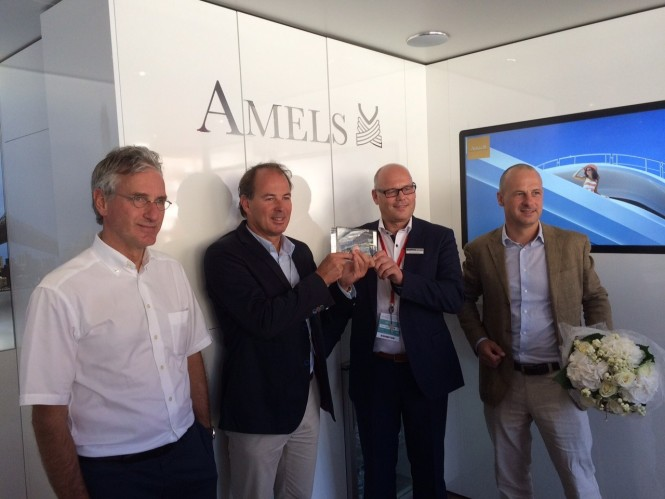 During the jubilee ceremony, Raytheon Anschütz' Arno Nommensen hands over a certificate about the 100th Superyacht INS to AMELS' Victor Caminada and Martin van Heulen