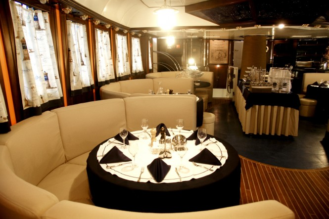 Formal dining aboard superyacht RUNNING ON WAVES