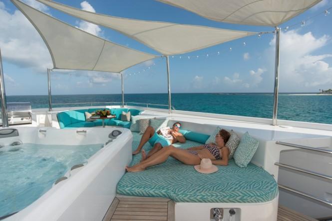 Enjoying the lovely sunshine and summer breeze around the Jacuzzi aboard RHINO