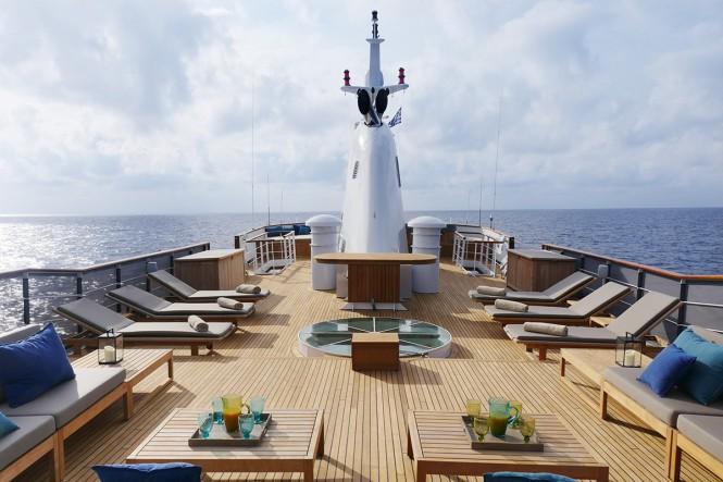 Sunbathing in style aboard MENORCA - Photo credit Mare e Terra