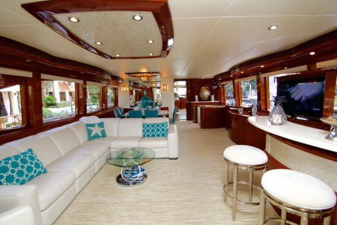 Luxury yacht EXIT STRATEGY - Salon and formal dining area with bar