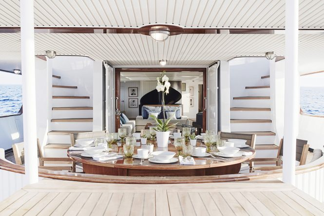 Al fresco dining on the aft deck of classic yacht MENORCA. Photo credit Mare e Terra