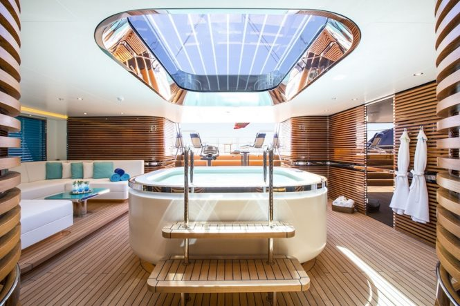 Luxury yacht AQuiJo beachclub Jacuzzi and gym equipment - Photo by Stuart Pearce