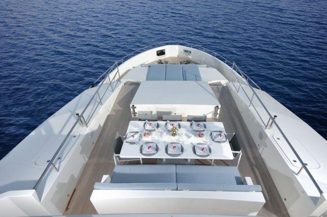 Luxury yacht SERENITAS - Alfresco dining and sunbathing on the bow