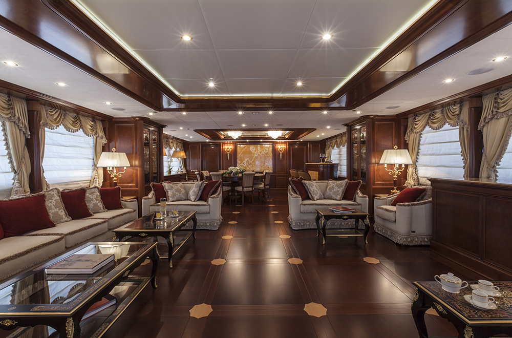 Main salon and formal dining area with bar aboard superyacht PRIDE