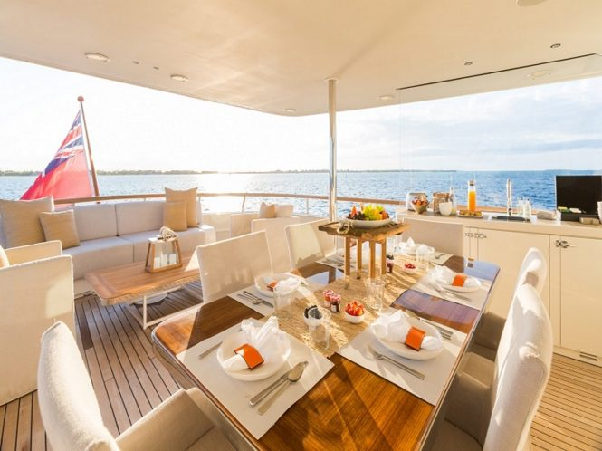 Motor yacht PIONEER - Alfresco dining and lounging on the upper aft deck
