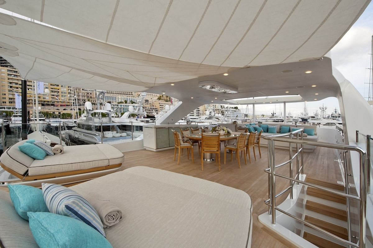Sundeck sunpads and alfresco dining aboard motor yacht SCORPION