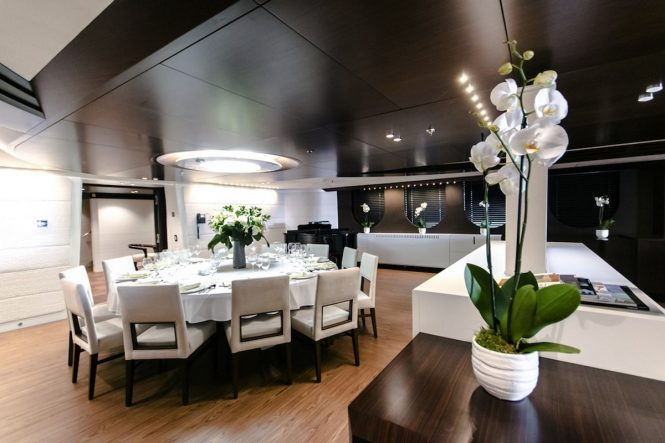 Superyacht KATINA - Formal dining area in the open plan main salon