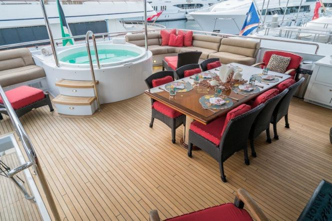 Superyacht NICOLE EVELYN - Upper deck alfresco dining and Jacuzzi