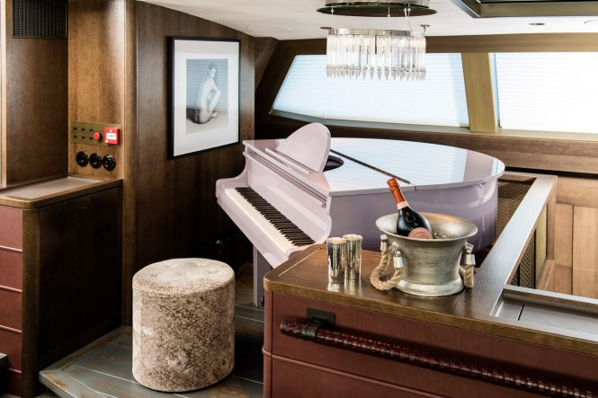 The upper salon baby grand piano aboard sailing yacht PINK GIN VI