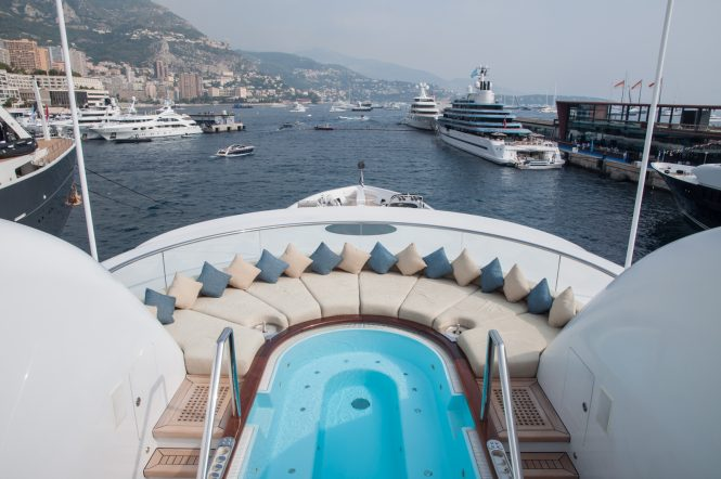 Anastasia at the Monaco Yacht Show 2017 - View of the mega yacht Jubilee in the background