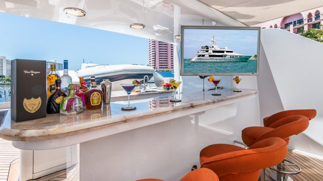 Deck bar with TV aboard CLAIRE
