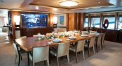 MYS 2017 ANASTASIA by Oceanco dining room with table setting and aquarium