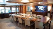 MYS - ANASTASIA dining table in the main saloon dining are with a huge aquarium