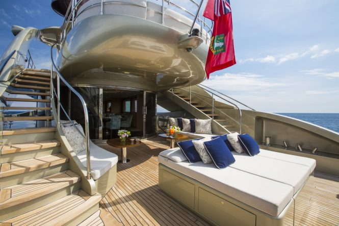 Main aft deck lounging and alfresco dining aboard luxury yacht MIDNIGHT SUN