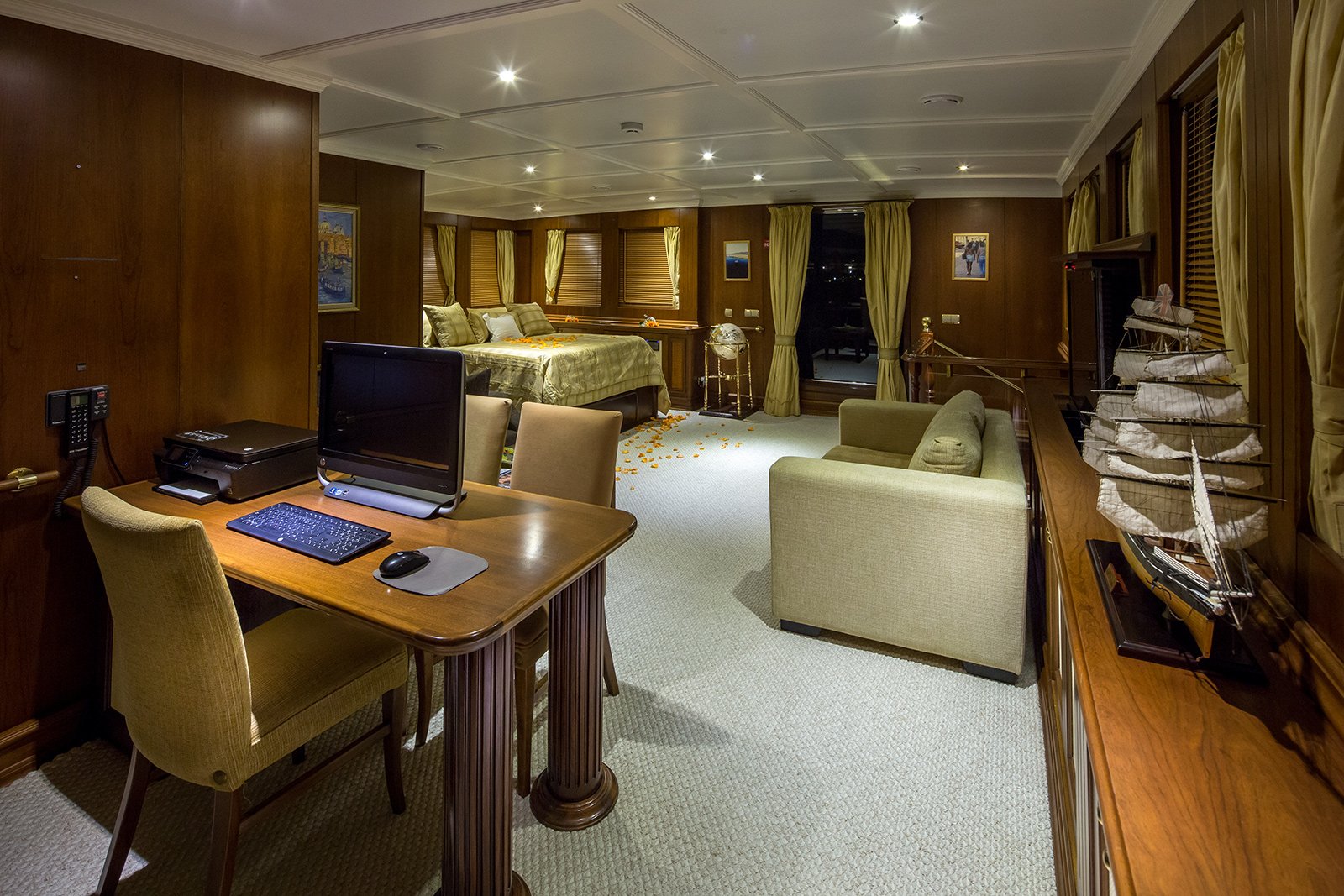 Master stateroom with a seating area and an office/study